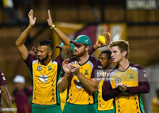 Providence Guyana 12 July 2016 Rayad Emrit Martin Guptill and Adam Zampa of Guyana Amazon Warriors wave to the fans after winning Match 13 of the...
