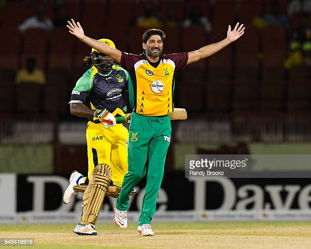 Providence Guyana 7 July 2016 Sohail Tanvir right of Guyana Amazon Warriors dismisses Chris Gayle left of Jamaica Tallawahs during Match 9 of the...