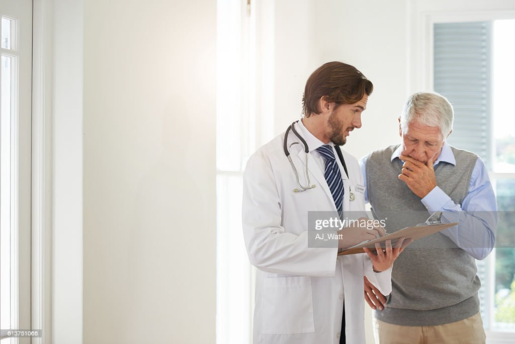 Providing the best medical care to his patient : Stock Photo