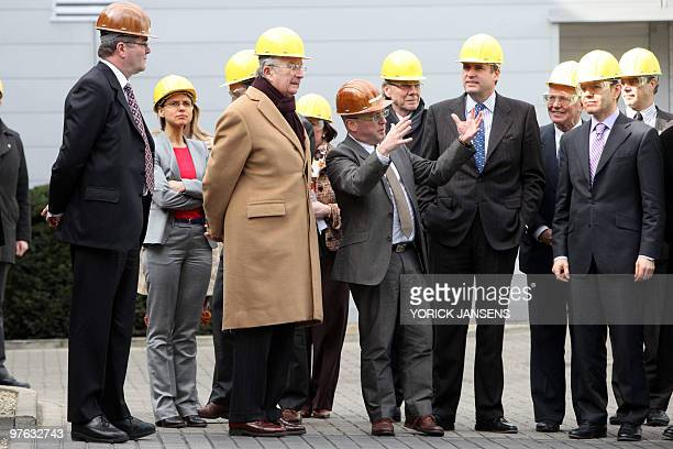 Province governor of Antwerp Cathy Berx and King Albert II of Belgium listen during a visit to the technology group Umicore's production site in...