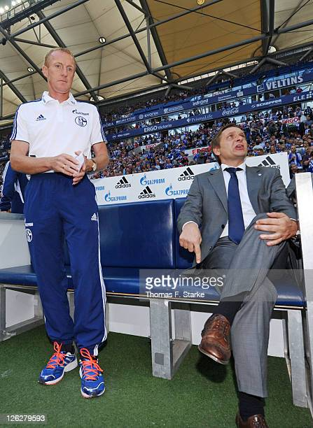 Provisional coach Josef Seppo Eichkorn and manager Horst Heldt of Schalke sit on the substitutes bench prior to the Bundesliga match between FC...