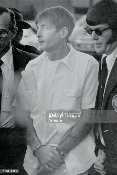 Provo, Utah.: Condemned killer Gary Gilmore, gaunt and pale on the 13th day of a hunger strike, is led into Utah County Courthouse. Fourth District...