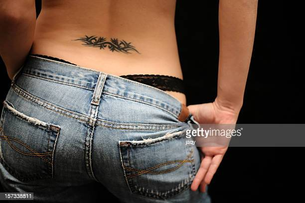provocative tattoo - woman bum stock photos and pictures
