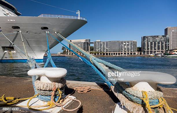 Prow of a cruise ship docked and tied to moorings in Sydney Harbor, New South Wales, Australia