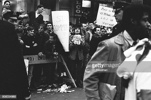 Prowar protestors and veterans of the Bay of Pigs attend a peace march in New York City calling for an end to the Vietnam War USA 1967