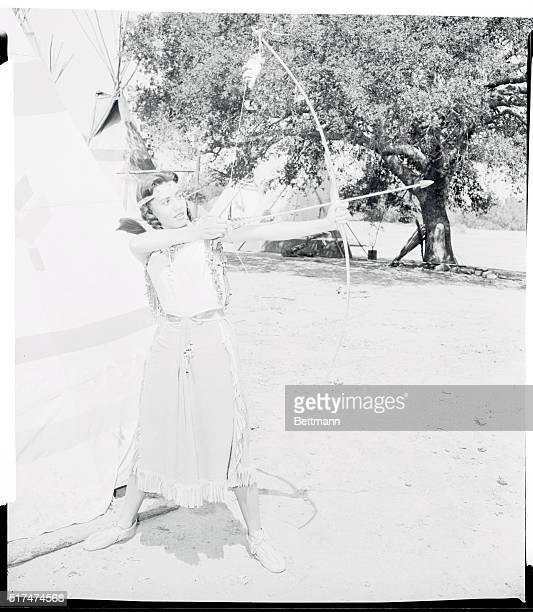 Prowess with a bow and arrow isn't part of Kim's TV role but she shows form that would make many a Redskin brave green with envy She learned how to...