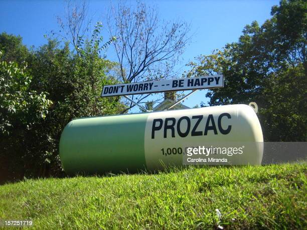 A prozac gas tank art stands on a hill in Red Hook New York