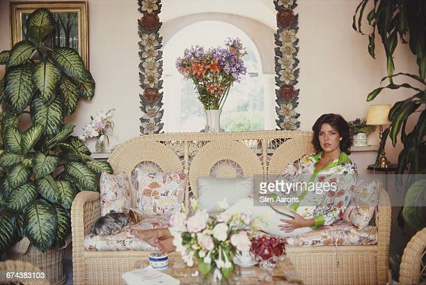 Prrincess Caroline of Monaco in the winter-garden room of her house on the palace grounds, Monte Carlo, Monaco, August 1981.