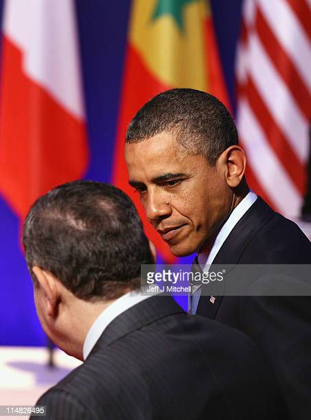 Prsident Barack Obama talks with Egyptian Prime Minister Essam Sharaf as leaders pose during the family photo at the G8 Summitt on May 27 2011 in...
