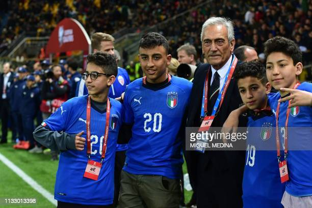 Prsident of the Italian Football Federation Gabriele Gravina poses with schoolchildren Adam Ramy Shehata and two others who helped police after being...