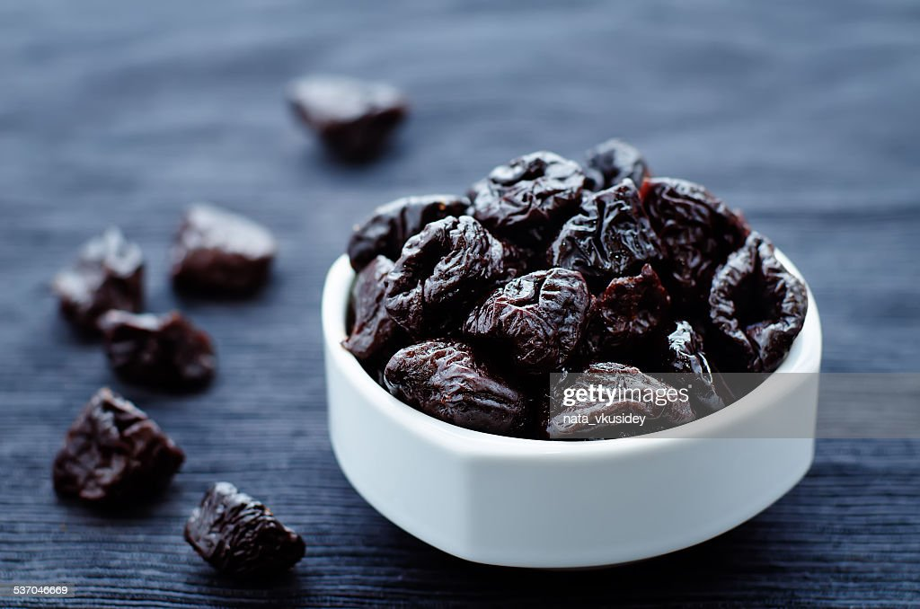 prunes in a bowl : Stock Photo