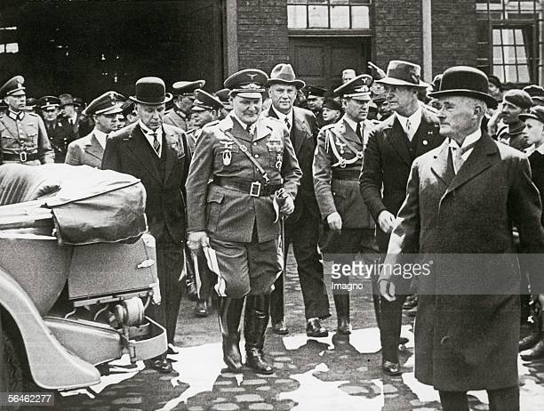 "Prussian Prime Minister Hermann Goering is visiting the ""Krupp Werke"". In the front : Alfred Krupp of Bohlen and Halbach. Essen. Germany...."