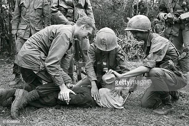 Prying replies to their questions out of an uncooperative Viet Cong suspect First Air Cavalrymen and a Vietnamese interpreter attached to the...