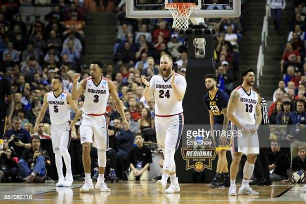 Przemek Karnowski and Johnathan Williams of the Gonzaga Bulldogs react in the second half against the West Virginia Mountaineers during the 2017 NCAA...