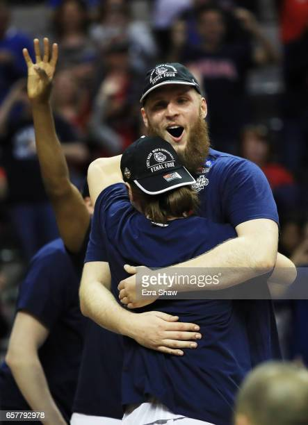 Przemek Karnowski and Rem Bakamus of the Gonzaga Bulldogs celebrate their 83 to 59 win over the Xavier Musketeers during the 2017 NCAA Men's...