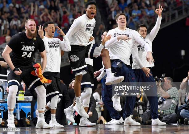 Przemek Karnowski and the Gonzaga Bulldogs bench reacts to a 3pointer against the North Carolina Tar Heels during the 2017 NCAA Men's Final Four...