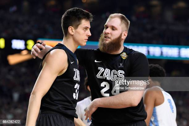 Przemek Karnowski and Zach Collins of the Gonzaga Bulldogs react to a play during the 2017 NCAA Men's Final Four National Championship game against...