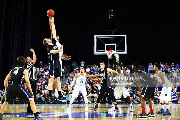 Przemek Karnowski of the Gonzaga Bulldogs and Jahlil Okafor of the Duke Blue Devils jump for the opening tip off during the South Regional Final of...