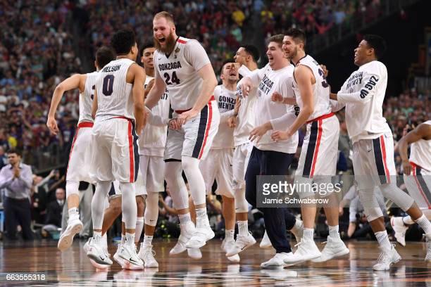 Przemek Karnowski of the Gonzaga Bulldogs and teammates react during the 2017 NCAA Photos via Getty Images Men's Final Four Semifinal at University...
