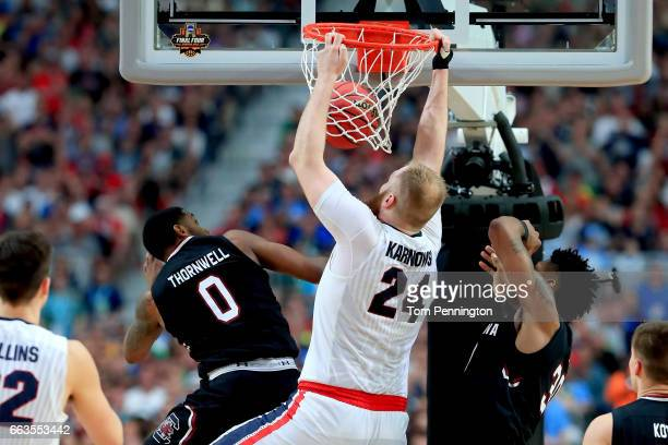 Przemek Karnowski of the Gonzaga Bulldogs dunks against Sindarius Thornwell of the South Carolina Gamecocks in the second half during the 2017 NCAA...