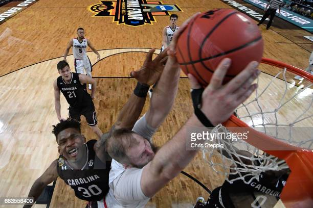 Przemek Karnowski of the Gonzaga Bulldogs goes in for a dunk during the 2017 NCAA Men's Final Four Semifinal against Chris Silva of the South...