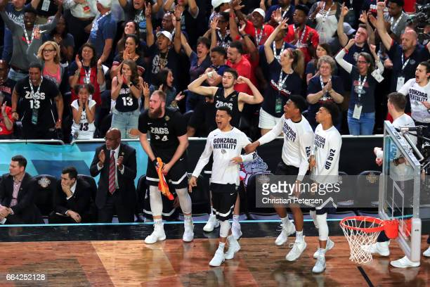 Przemek Karnowski of the Gonzaga Bulldogs reacts with teammates on the bench and fans in the first half against the North Carolina Tar Heels during...