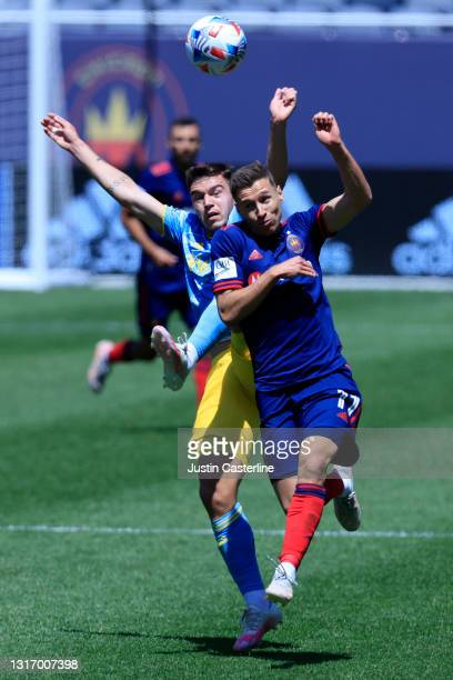 Przemysław Frankowski of the Chicago Fire and Kai Wagner of the Philadelphia Union fight for the ball during the first half at Soldier Field on May...