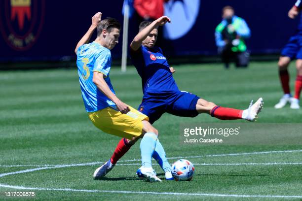Przemysław Frankowski of the Chicago Fire attempts to block the pass by Jack Elliott of the Philadelphia Union during the first half at Soldier Field...