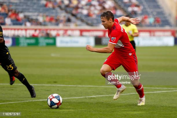 Przemysław Frankowski of the Chicago Fire brings the ball in the game against the Columbus Crew SC at SeatGeek Stadium on July 17 2019 in Bridgeview...