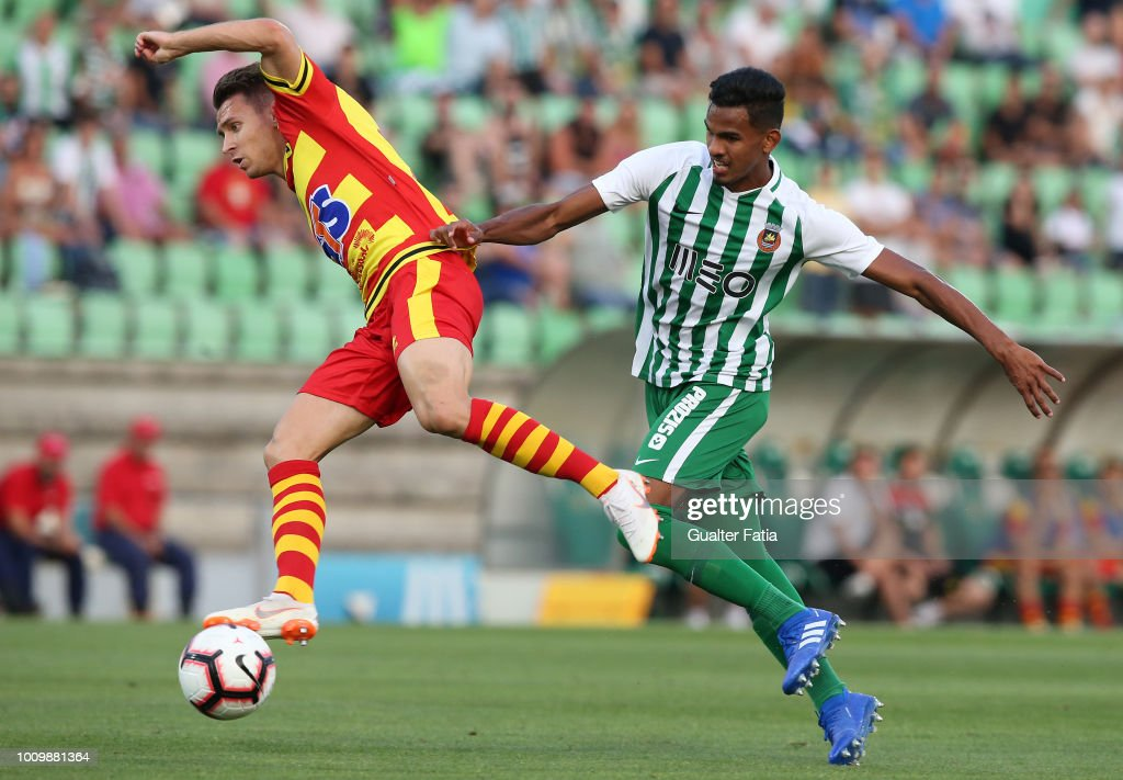Przemyslaw Frankowski of Jagiellonia competes for the ball with Wenderson Galeno of Rio Ave FC in action during the UEFA Europa League Second Qualifying Round 2nd Leg match between Rio Ave FC and Jagiellonia at Estadio dos Arcos on August 2, 2018 in Vila do Conde, Portugal.