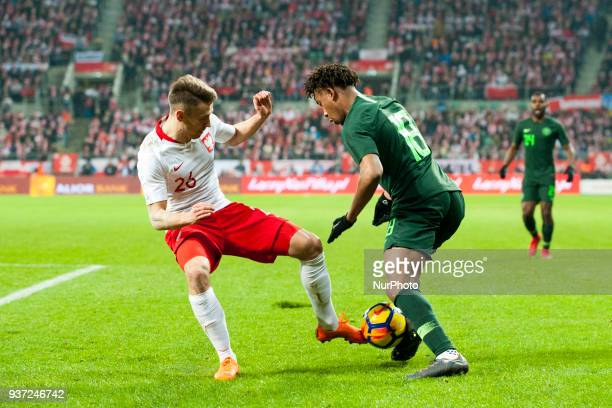 Przemyslaw Frankowski of Poland and Alex Iwobi of Nigeria fight for the ball during the international friendly match between Poland and Nigeria at...