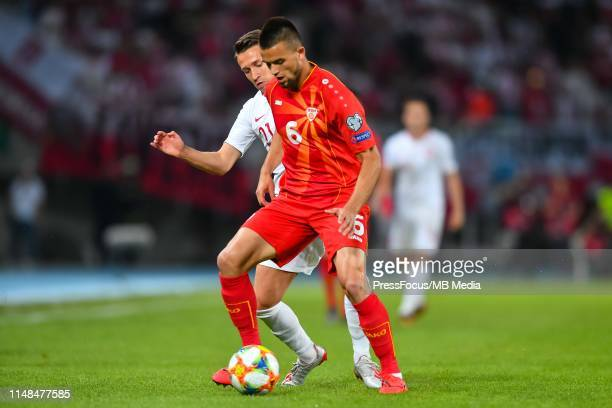 Przemyslaw Frankowski of Poland competes for the ball with Visar Musliu of North Macedonia during the 2020 UEFA European Championships group G...