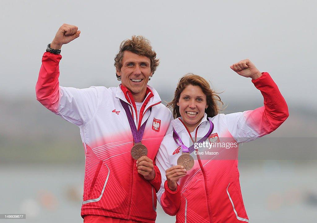 Przemyslaw Miarczynski and Zofia Noceti-Klepacka of Poland celebrate with their bronze medals won in the Men's and Women's