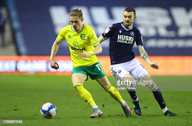 Przemyslaw Placheta of Norwich City is put under pressure by Scott Malone of Millwall FC during the Sky Bet Championship match between Millwall and...