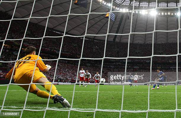 Przemyslaw Tyton of Poland saves Giorgos Karagounis of Greece's penalty during the UEFA EURO 2012 group A match between Poland and Greece at The...
