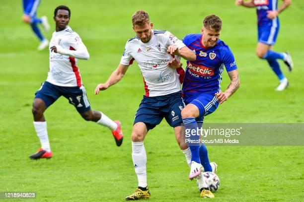 Przemyslaw Wisniewski of Gornik tackles Piotr Parzyszek of Piast during the PKO Ekstraklasa match between Gornika Zabrze and Piast Gliwice at Ernest...