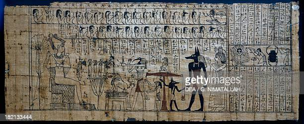 Psicostasia or weighing of the soul Anubis the jackalheaded funerary god adjusts the scale with which to weigh the sins that are in the heart of the...