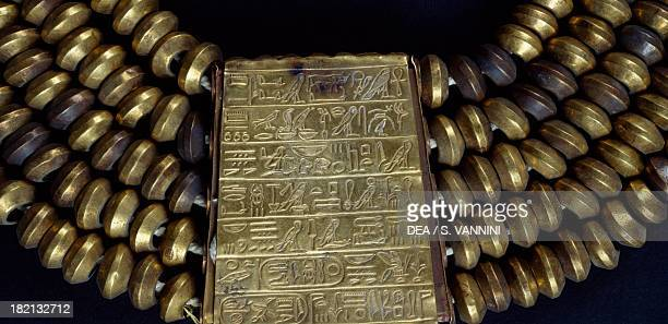 Psusennes I's collar adorned with cylindrical elements and a scroll gold and lapis lazuli dating from the reign of Psusennes I Detail Goldsmith art...