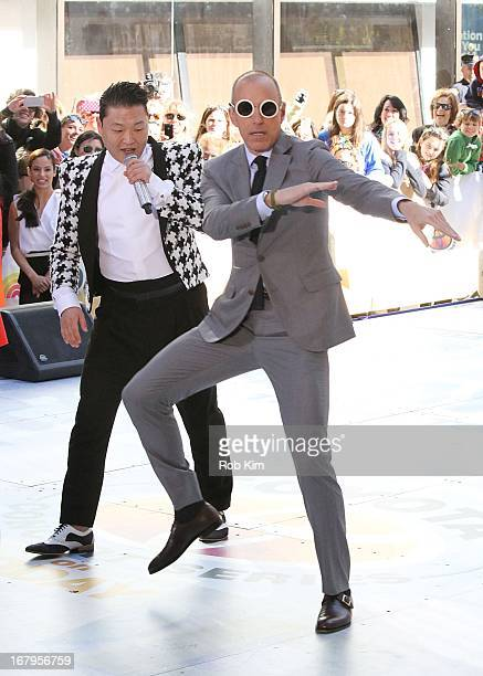 """Psy and host Matt Lauer on NBC's """"Today Show"""" at TODAY Plaza on May 3, 2013 in New York City."""
