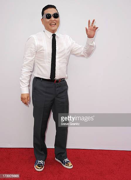 Psy arrives at the 'RED 2' Los Angeles Premiere at Westwood Village on July 11 2013 in Los Angeles California