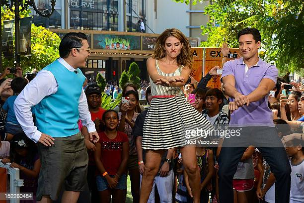 Psy Maria Menounos and Mario Lopez visits Extra at The Grove on September 17 2012 in Los Angeles California