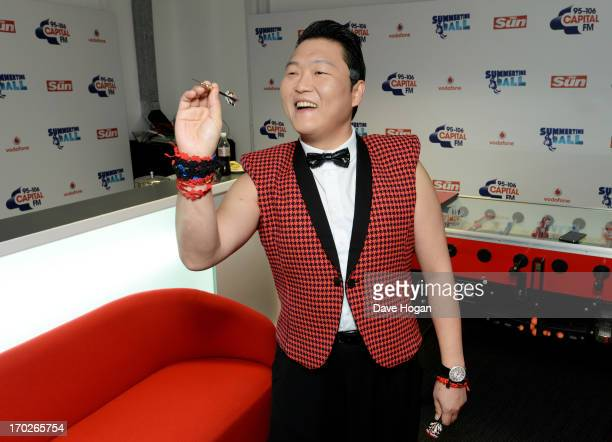 Psy poses in a backstage studio during the Capital Summertime Ball at Wembley Stadium on June 9 2013 in London England