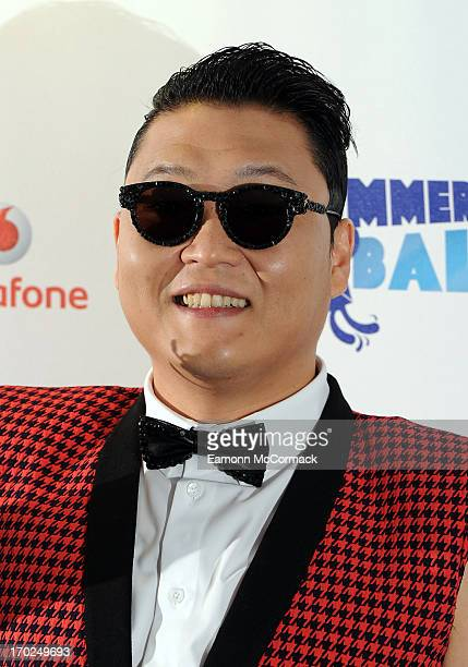 Psy poses in the Media Room at the Capital Summertime Ball at Wembley Arena on June 9 2013 in London England