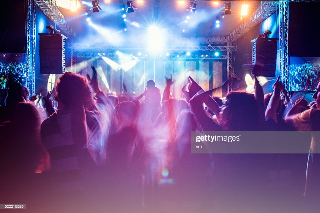 Psychedelic concert crowd : Stock Photo