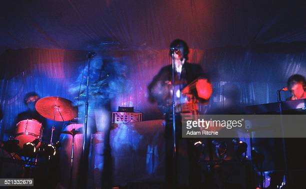 A psychedelic light show surrounds Nick Mason Roger Waters Syd Barrett and Rick Wright of Pink Floyd as they perform at the Architectural Association...