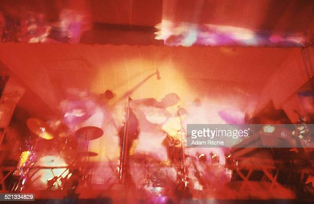 Psychedelic light show surrounds Nick Mason, Roger Waters, Syd Barrett and Rick Wright of Pink Floyd as they perform at the UFO Club, London, 23rd...