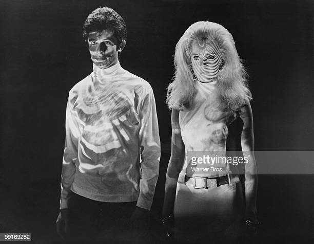 Psychedelic lights play on George Chakiris and Karin Mossberg in 'The Big Cube', directed by Tito Davison 1969.