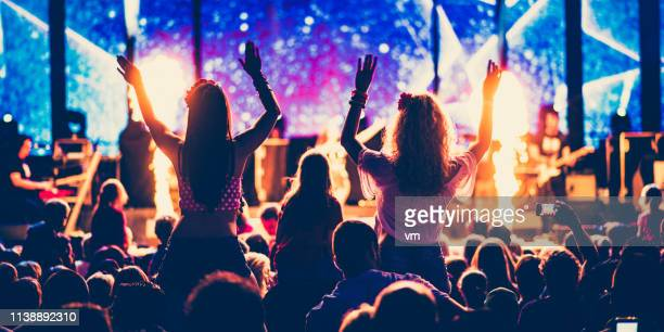 psychedelic rock concert crowd - rock band stock photos and pictures