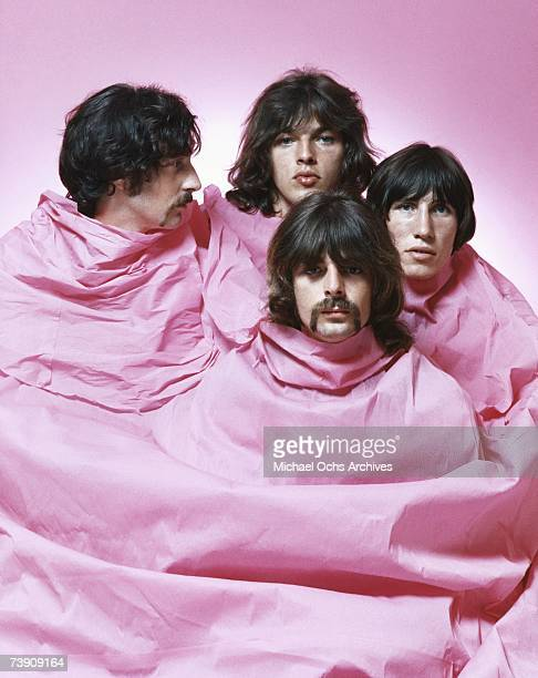 Psychedelic rock group Pink Floyd pose for a portrait shrouded in pink in August of 1968 in Los Angeles Nick Mason Dave Gilmour Rick Wright Roger...