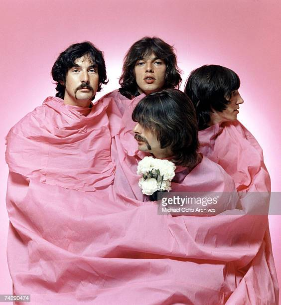 Psychedelic rock group Pink Floyd pose for a portrait shrouded in pink in August of 1968 in Los Angeles. Nick Mason, Dave Gilmour, Rick Wright ,...